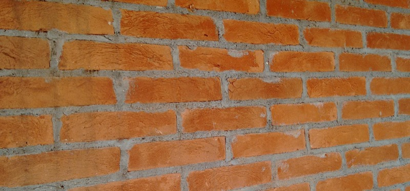 Revestimento massa raspada tijolo vermelho
