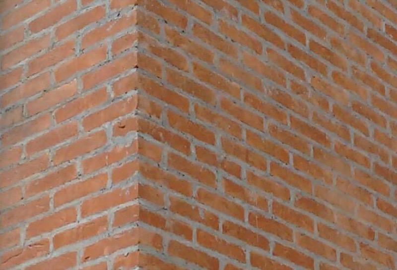 Revestimento rústico massa raspada tijolo vermelho